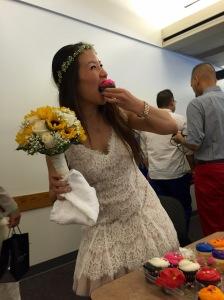 Bride eats cupcake.